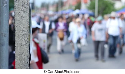 Crowded Streets - Blurred thousands of people walking in the...