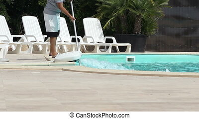 Pool Maintenance Works - An employee doing maintenance work...