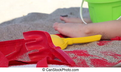 Beach Toys - Colorful beach toys are placed on the hot sand...