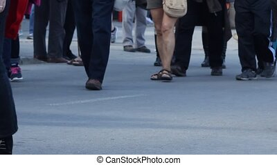 Crowded Place with Walking People - Details of feet, legs,...