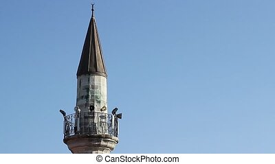 Minaret of a Mosque - Minaret of a mosque in a clear sky...
