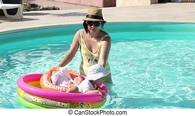 Mother and Daughter at Pool - Mother and her little girl are...