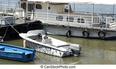 Motorized Boat on River - Motorized boat tied on the shore...