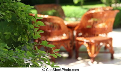Wicker Chairs in Garden - Changing focus to some relaxing...
