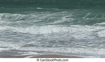 Big Green Waves on Shore - Close up shot with foamy green...
