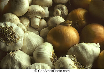 Garlic mushrooms and onions in a pile