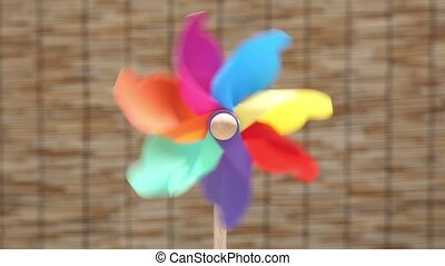 toy pinwheel on bamboo curtain background