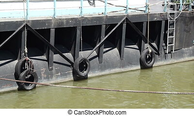 Floating Tyres on Boat - River ship has hanges floating...