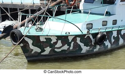 Jalopy Boat - A camouflaged painted hull boat, not in the...