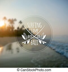 White surfing camp logo on blurred ocean sunrise photo background