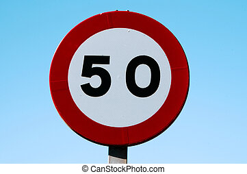 traffic signal - speed limit signs to 50 on blue sky