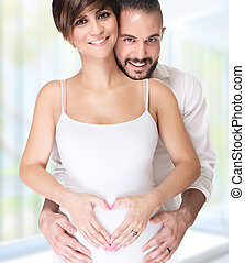 Happy couple enjoying pregnancy - Portrait of beautiful...