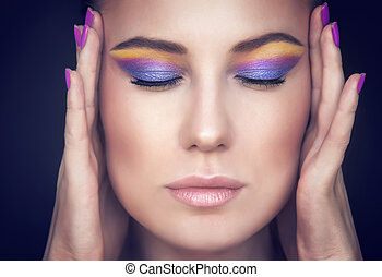 Beautiful woman face with colorful makeup - Closeup portrait...