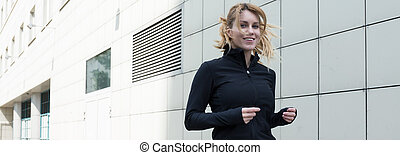 Happy femal runner - Young woman is happy when she runs