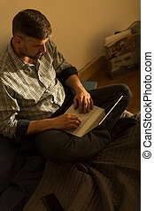 Single man and his laptop - Single adult man is typing...
