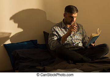 Single man and a book - Single man is reading in the lonely...