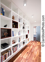 White book shelf in office with wooden floor