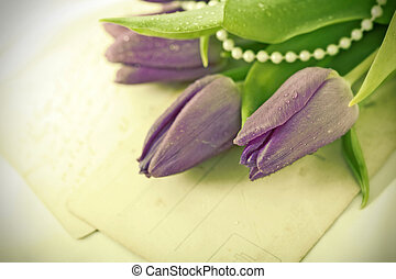 Old love letters and purple tulips Retro style toned picture...