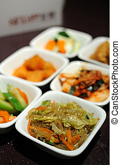 Korean cuisine side dishes - kimchi and various kind of...