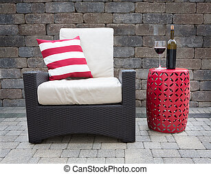 Red Wine on Table Next to Chair on Upscale Patio -...