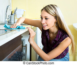 Housewife cleaning kitchen - Beautiful young housewife...