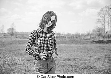 Girl with vintage photo camera. Black-white photo. - Happy...
