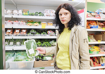 Woman shopping in supermarket - MOSCOW, RUSSIA - APRIL 09,...