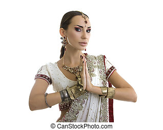 Beautiful Indian Woman in Traditional Sari Clothing with Bridal Makeup and oriental jewelry. Namaste.