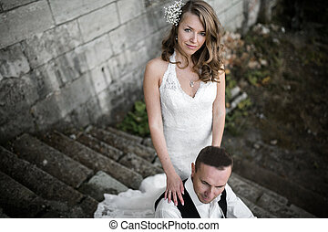 beautiful couple resting on the stone steps