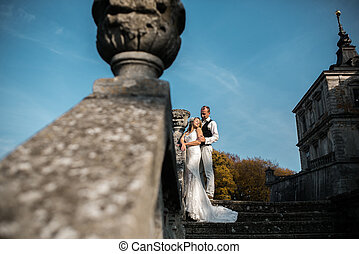 beautiful couple posing on the stone steps