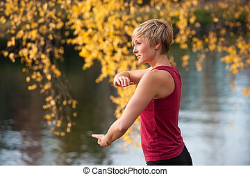 Tai Chi - A young Caucasian woman doing Tai Chi