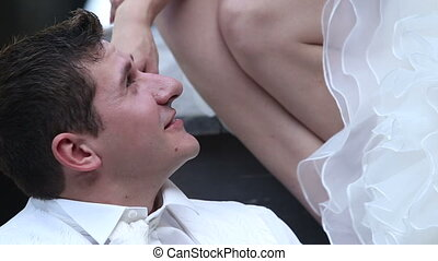 european bride strokes groom cheek in longtail boat - blonde...
