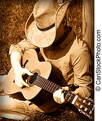Cowboy plays guitar - Cowboy plays guitar on ranch .Country...