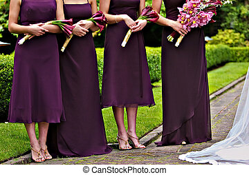 Bridesmaids - Four young and beautiful bridemaids with...