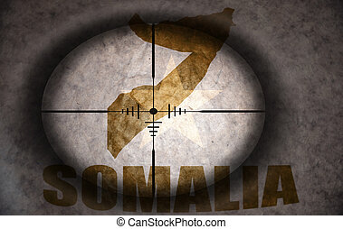 sniper scope aimed at the vintage somalia flag and map