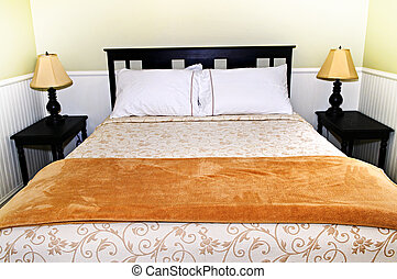 Bedroom interior with comfortable queen size bed