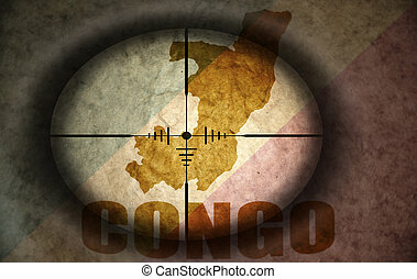 sniper scope aimed at the vintage congolese flag and map