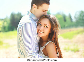 Closeup portrait of happy young couple in love, sunny summer...