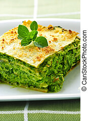 Plate of vegeterian lasagna - Serving of fresh baked...