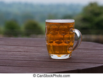 pint of beer in beer garden - traditional pint of bitter...
