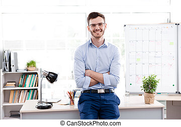 Concept for young businessman in office - Young businessman...