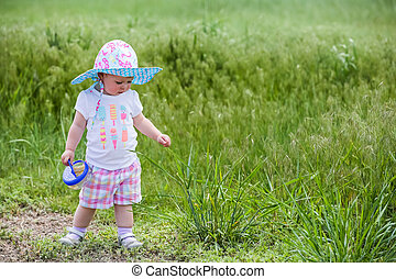 Toddler girl - Cute toddler girl playing on the farm in the...