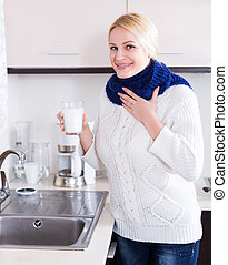 Woman standing with gargle solution - Cheerful woman...