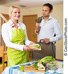 Delicious sandwich for husband - Woman preparing a delicious...