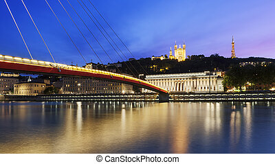 Large view of Saone river at sunset in Lyon city