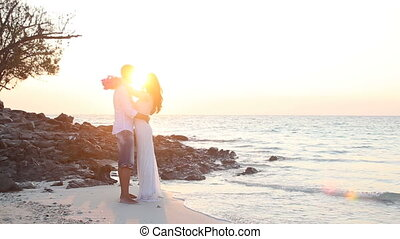 bride with wedding bouquet embrace groom at sunrise