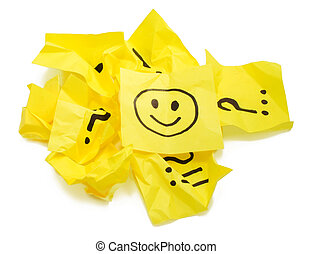 Several crushed yellow stickers, one with smile - Several...