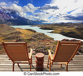 Chilean national park Torres del Paine - Wooden chairs in...