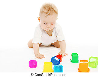Baby playing with colorful toys on the floor