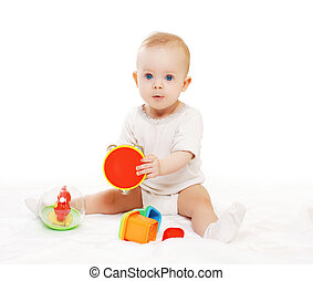Portrait of baby sitting and playing with colorful toys